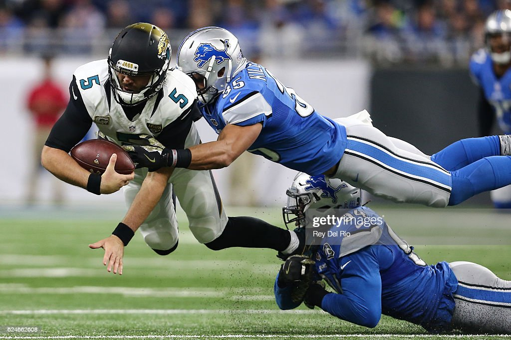 Miles Killebrew #35 of the Detroit Lions and Ezekiel Ansah #94 of the Detroit Lions tackle quarterback Blake Bortles #5 of the Jacksonville Jaguars during first half action at Ford Field on November 20, 2016 in Detroit, Michigan.