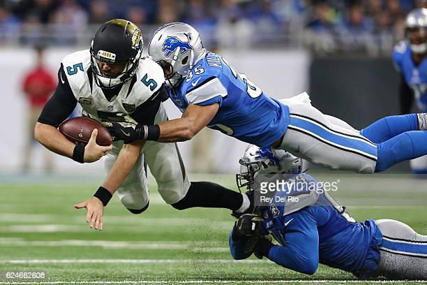 Miles Killebrew of the Detroit Lions and Ezekiel Ansah of the Detroit Lions tackle quarterback Blake Bortles of the Jacksonville Jaguars during first...