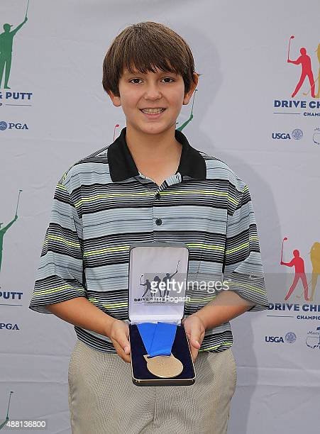 Miles Martin first place winner in the Boys 1011 Chipping Competition poses with his medal during the 2015 Drive Chip and Putt Championship at The...