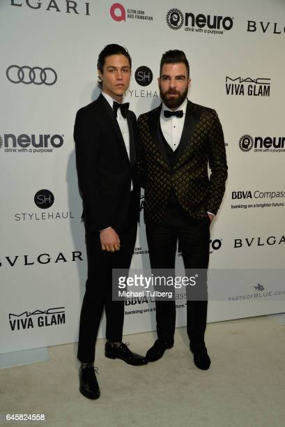 Miles McMillan and Zachary Quinto attend the 25th Annual Elton John AIDS Foundation's Academy Awards Viewing Party at The City of West Hollywood Park...