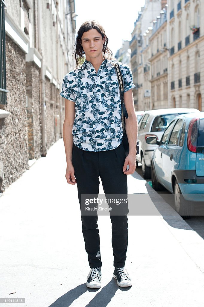 Miles McMillan male model wearing a Richard Chai shirt, Paul Smith trousers, converse trainers and a patrick Ervell bag at Paris Fashion Week Spring/Summer 2013 menswear shows on July 01, 2012 in Paris, France..