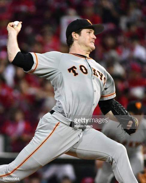 Miles Mikolas pitches as the Yomiuri Giants' starter in a game against the Hiroshima Carp at Mazda Stadium in Hiroshima on Sept 22 2017 The freeagent...