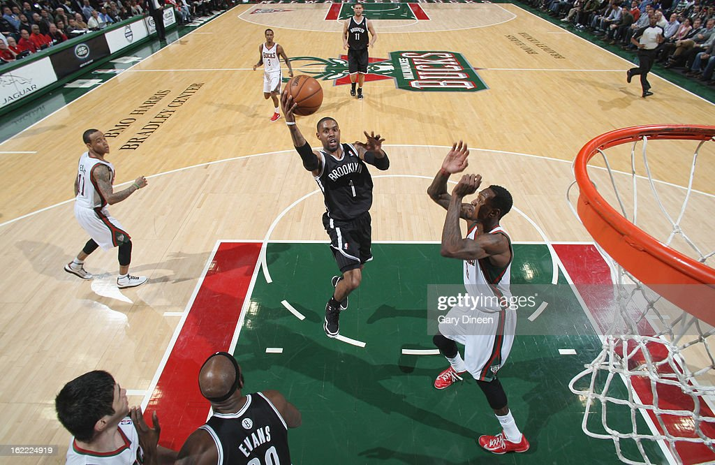 <a gi-track='captionPersonalityLinkClicked' href=/galleries/search?phrase=C.J.+Miles&family=editorial&specificpeople=641491 ng-click='$event.stopPropagation()'>C.J. Miles</a> #1 of the Brooklyn Nets shoots against Larry Sanders #8 of the Milwaukee Bucks on February 20, 2013 at the BMO Harris Bradley Center in Milwaukee, Wisconsin.