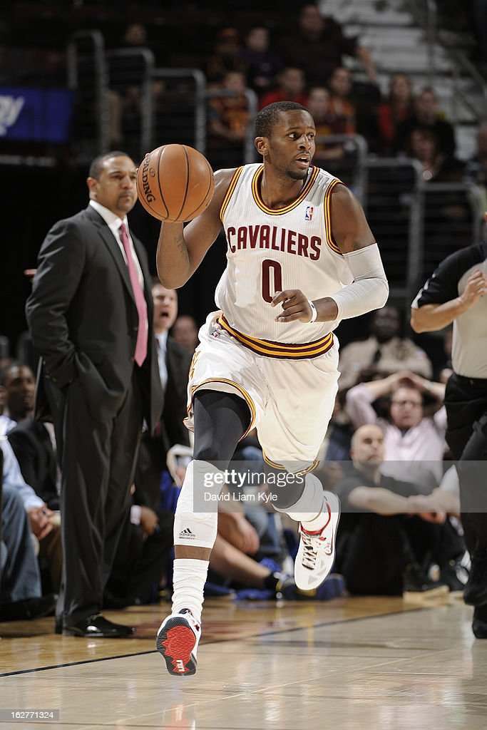 <a gi-track='captionPersonalityLinkClicked' href=/galleries/search?phrase=C.J.+Miles&family=editorial&specificpeople=641491 ng-click='$event.stopPropagation()'>C.J. Miles</a> #0 of the Cleveland Cavaliers brings the ball up court against the Golden State Warriors at The Quicken Loans Arena on January 29, 2013 in Cleveland, Ohio.