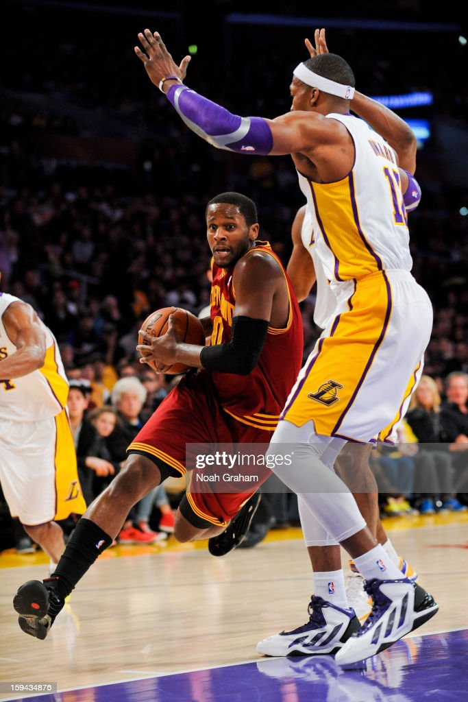 C.J. Miles #0 of the Cleveland Cavaliers drives against Dwight Howard #12 of the Los Angeles Lakers at Staples Center on January 13, 2013 in Los Angeles, California.