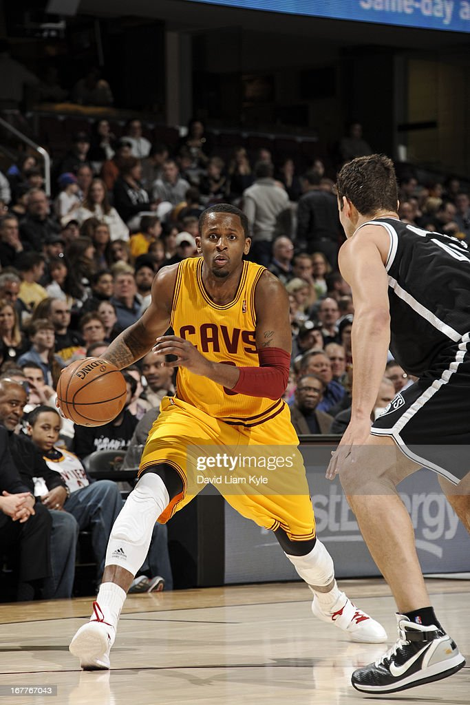<a gi-track='captionPersonalityLinkClicked' href=/galleries/search?phrase=C.J.+Miles&family=editorial&specificpeople=641491 ng-click='$event.stopPropagation()'>C.J. Miles</a> #0 of the Cleveland Cavaliers drives against <a gi-track='captionPersonalityLinkClicked' href=/galleries/search?phrase=Kris+Humphries&family=editorial&specificpeople=209199 ng-click='$event.stopPropagation()'>Kris Humphries</a> #43 of the Brooklyn Nets at The Quicken Loans Arena on April 3, 2013 in Cleveland, Ohio.