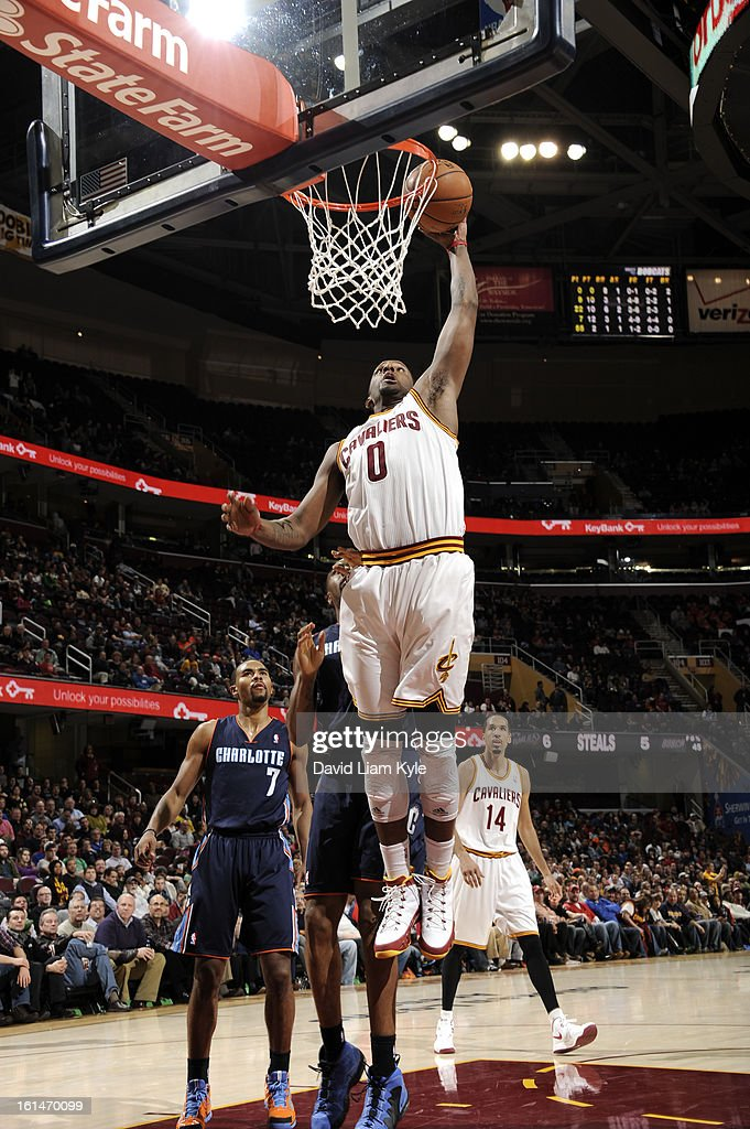 <a gi-track='captionPersonalityLinkClicked' href=/galleries/search?phrase=C.J.+Miles&family=editorial&specificpeople=641491 ng-click='$event.stopPropagation()'>C.J. Miles</a> #0 of the Cleveland Cavaliers drives against of the Charlotte Bobcats at The Quicken Loans Arena on February 6, 2013 in Cleveland, Ohio.