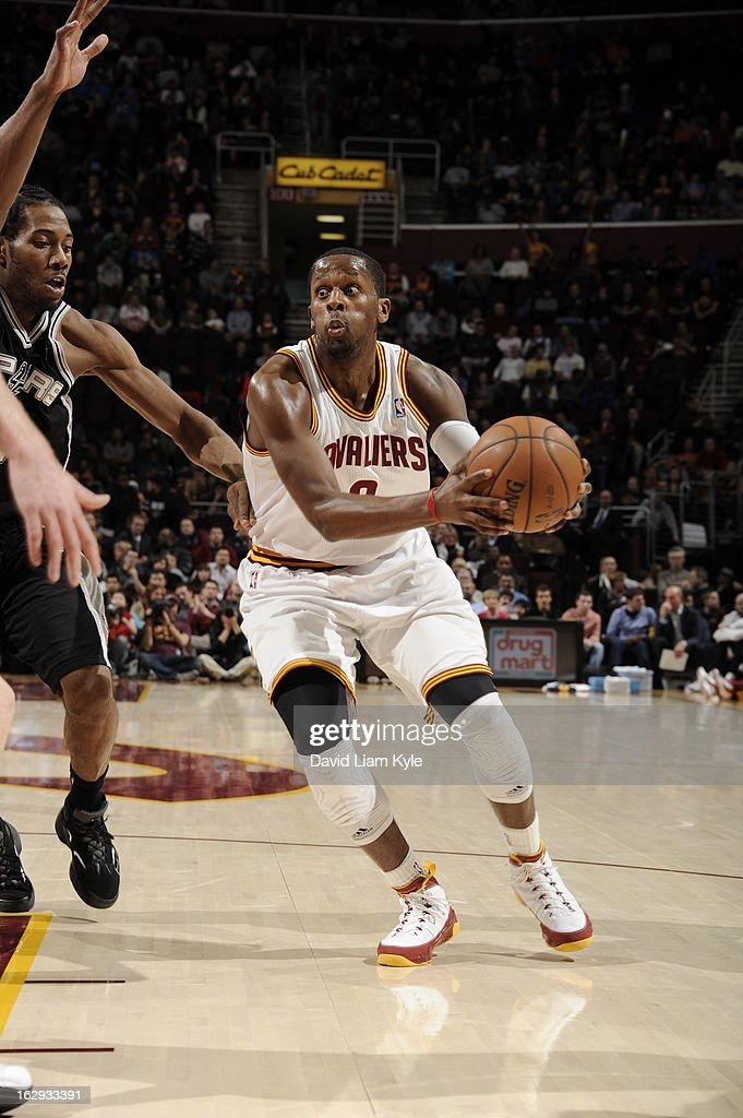 <a gi-track='captionPersonalityLinkClicked' href=/galleries/search?phrase=C.J.+Miles&family=editorial&specificpeople=641491 ng-click='$event.stopPropagation()'>C.J. Miles</a> #0 of the Cleveland Cavaliers drives against the San Antonio Spurs at The Quicken Loans Arena on February 13, 2013 in Cleveland, Ohio.
