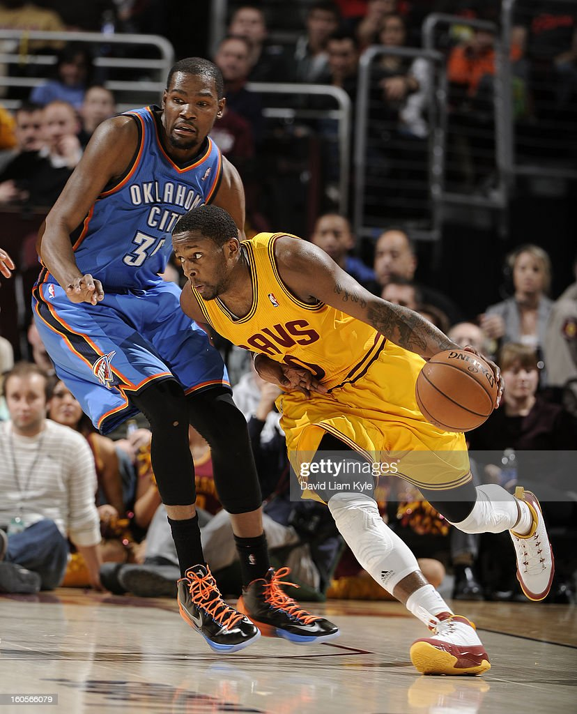 C.J. Miles #0 of the Cleveland Cavaliers drives to the basket against Kevin Durant #35 of the Oklahoma City Thunder at The Quicken Loans Arena on February 2, 2013 in Cleveland, Ohio.