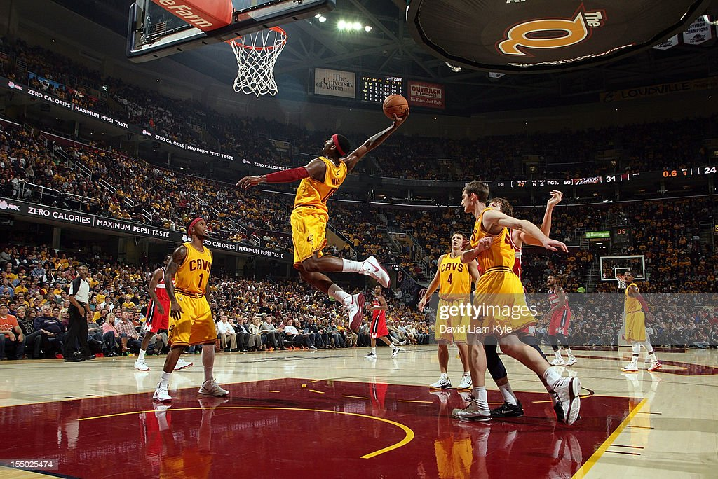 <a gi-track='captionPersonalityLinkClicked' href=/galleries/search?phrase=C.J.+Miles&family=editorial&specificpeople=641491 ng-click='$event.stopPropagation()'>C.J. Miles</a> #0 of the Cleveland Cavaliers flies high t grab the rebound in the game against the Washington Wizards at The Quicken Loans Arena on October 30, 2012 in Cleveland, Ohio.