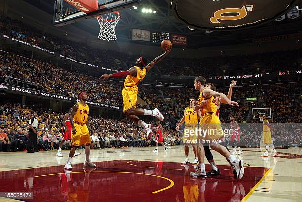 J Miles of the Cleveland Cavaliers flies high t grab the rebound in the game against the Washington Wizards at The Quicken Loans Arena on October 30...