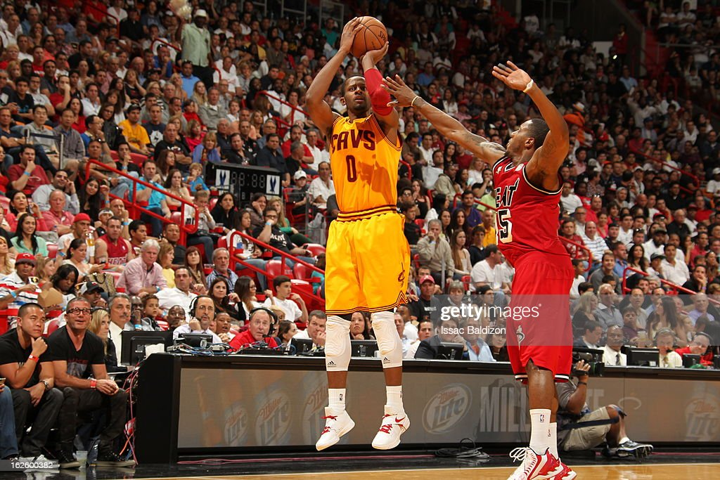 <a gi-track='captionPersonalityLinkClicked' href=/galleries/search?phrase=C.J.+Miles&family=editorial&specificpeople=641491 ng-click='$event.stopPropagation()'>C.J. Miles</a> #0 of the Cleveland Cavaliers goes for a jump shot against <a gi-track='captionPersonalityLinkClicked' href=/galleries/search?phrase=Mario+Chalmers&family=editorial&specificpeople=802115 ng-click='$event.stopPropagation()'>Mario Chalmers</a> #15 of the Miami Heat during a game between the Cleveland Cavaliers and the Miami Heat on February 24, 2013 at American Airlines Arena in Miami, Florida.