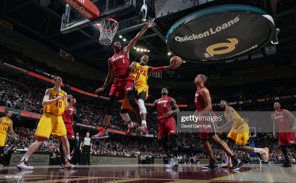 C.J. Miles #0 of the Cleveland Cavaliers goes up for the shot against Chris Bosh #1 of the Miami Heat at The Quicken Loans Arena on March 20, 2013 in Cleveland, Ohio.