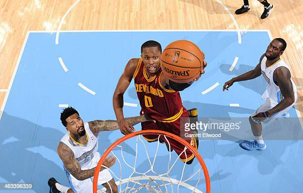 CJ Miles of the Cleveland Cavaliers making a layup during a game against the Denver Nuggets on January 17 2014 at the Pepsi Center in Denver Colorado...