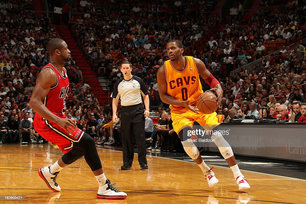 <a gi-track='captionPersonalityLinkClicked' href=/galleries/search?phrase=C.J.+Miles&family=editorial&specificpeople=641491 ng-click='$event.stopPropagation()'>C.J. Miles</a> #0 of the Cleveland Cavaliers protects the ball during a game between the Cleveland Cavaliers and the Miami Heat on February 24, 2013 at American Airlines Arena in Miami, Florida.