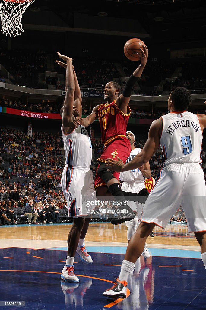 C.J. Miles #0 of the Cleveland Cavaliers shoots against Bismack Biyombo #0 of the Charlotte Bobcats at the Time Warner Cable Arena on January 4, 2013 in Charlotte, North Carolina.