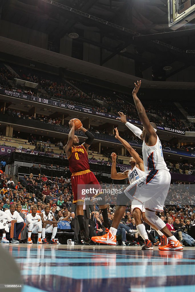 C.J. Miles #0 of the Cleveland Cavaliers shoots against the Charlotte Bobcats at the Time Warner Cable Arena on January 4, 2013 in Charlotte, North Carolina.