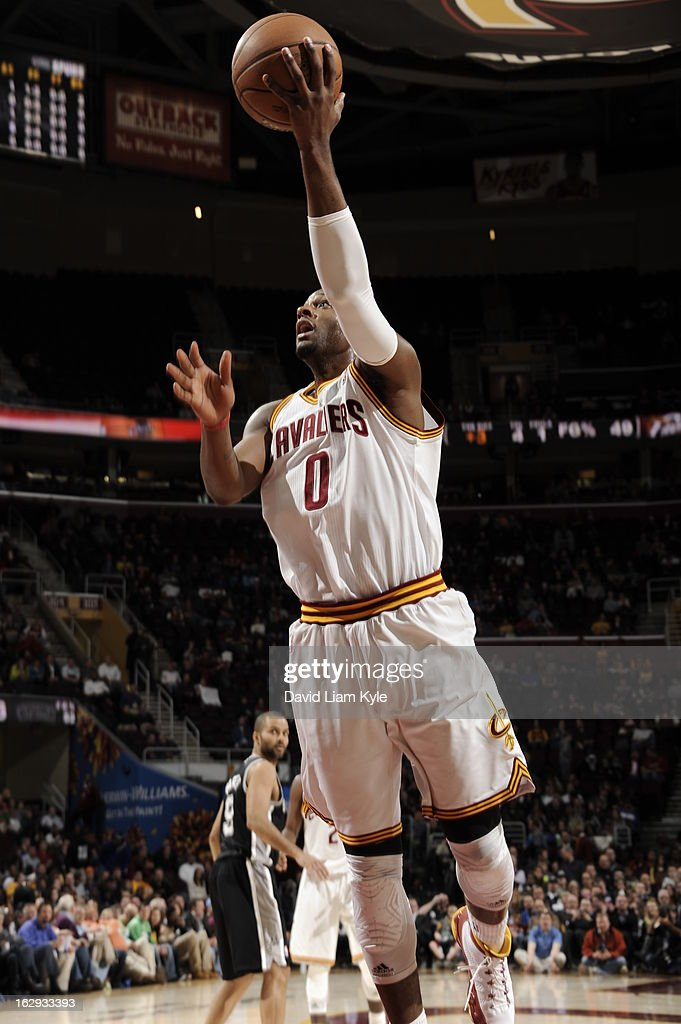 <a gi-track='captionPersonalityLinkClicked' href=/galleries/search?phrase=C.J.+Miles&family=editorial&specificpeople=641491 ng-click='$event.stopPropagation()'>C.J. Miles</a> #0 of the Cleveland Cavaliers shoots against the San Antonio Spurs at The Quicken Loans Arena on February 13, 2013 in Cleveland, Ohio.