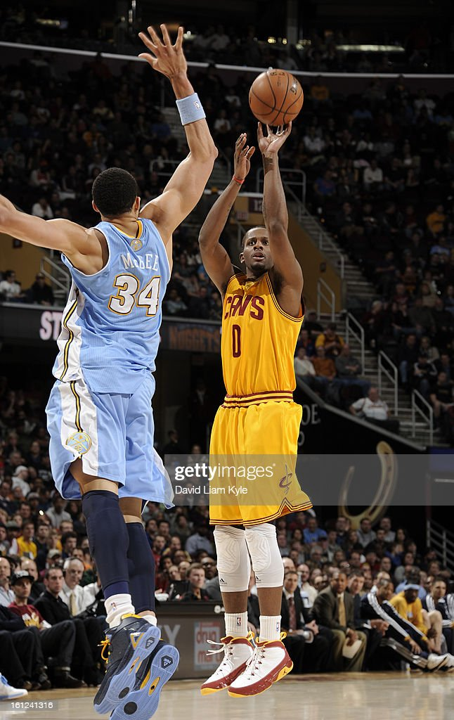 C.J. Miles #0 of the Cleveland Cavaliers shoots over JaVale McGee #34 of the Denver Nuggets at The Quicken Loans Arena on February 9, 2013 in Cleveland, Ohio.