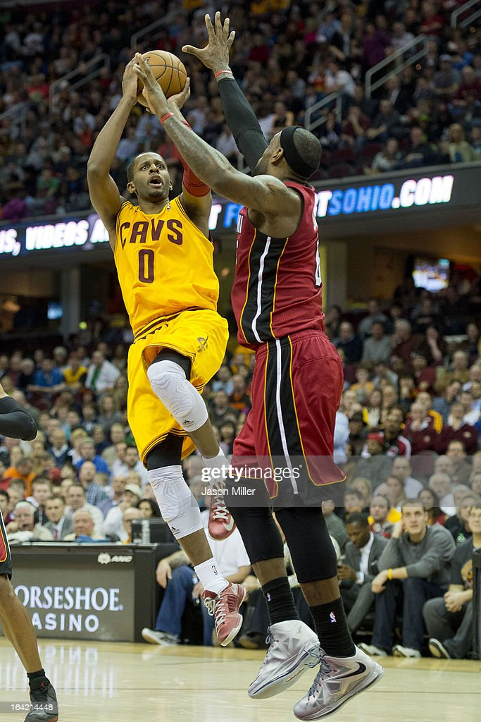 C.J. Miles #0 of the Cleveland Cavaliers shoots over LeBron James #6 of the Miami Heat during the second half at Quicken Loans Arena on March 20, 2013 in Cleveland, Ohio. The Heat defeated the Cavaliers 98-95.
