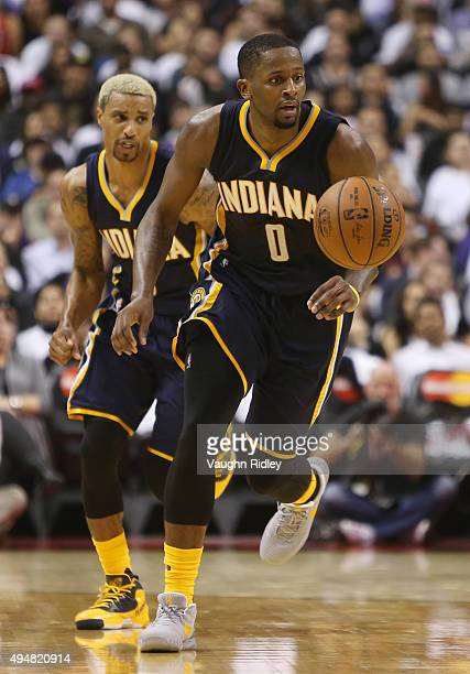 J Miles of the Indiana Pacers dribbles the ball during the NBA season opener against the Toronto Raptors at Air Canada Centre on October 28 2015 in...