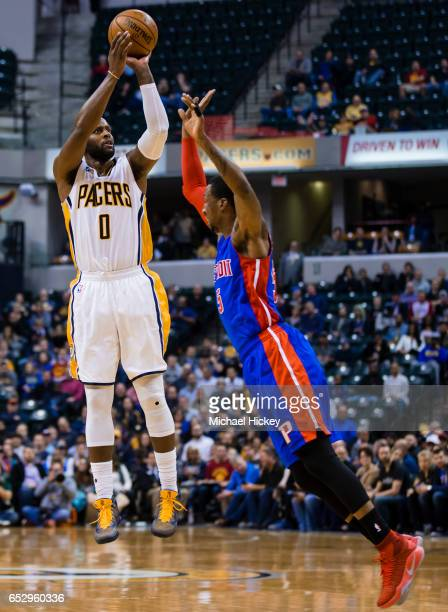 J Miles of the Indiana Pacers shoots the ball against Kentavious CaldwellPope of the Detroit Pistons at Bankers Life Fieldhouse on March 8 2017 in...