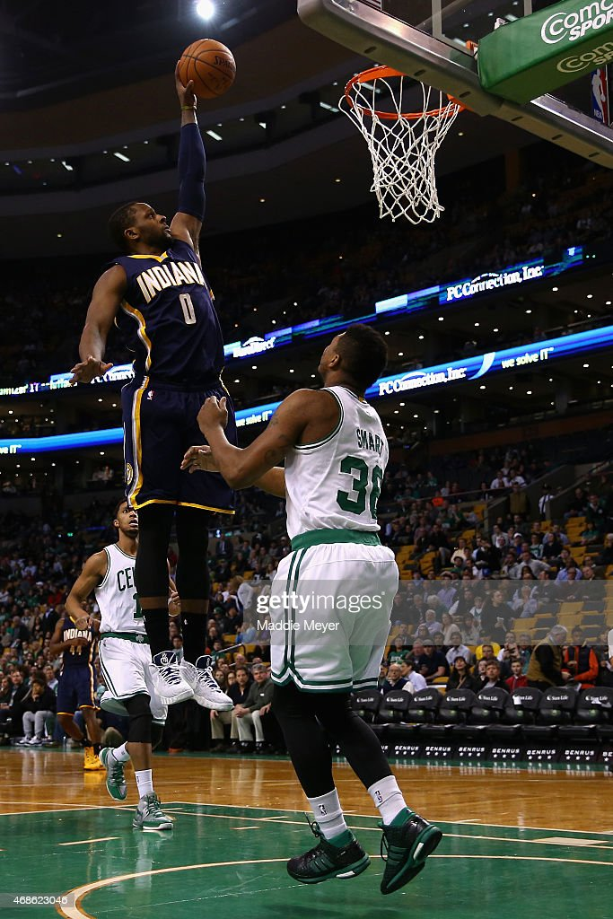 C.J. Miles #0 of the Indiana Pacers takes a shot over Marcus Smart #36 of the Boston Celtics during the first quarter at TD Garden on April 1, 2015 in Boston, Massachusetts.