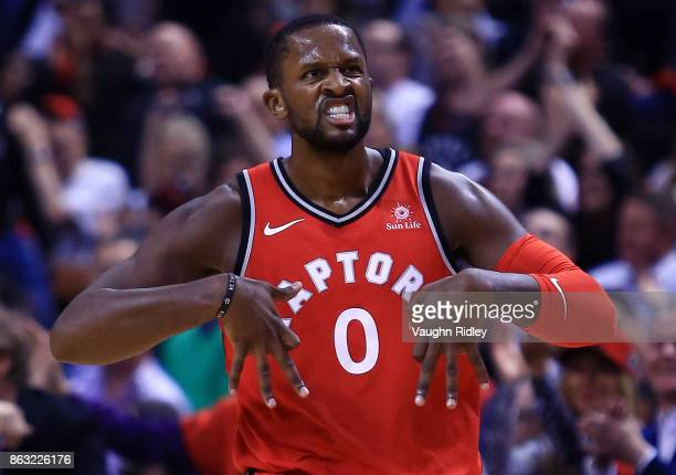 J Miles of the Toronto Raptors celebrates celebrates a 3 pointer during the first half of an NBA game against the Chicago Bulls at Air Canada Centre...