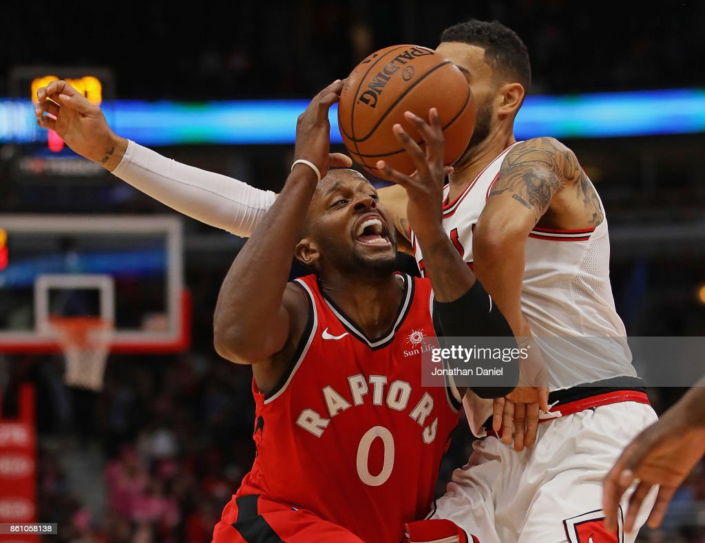Miles #0 of the Toronto Raptors tries to drive against Denzel Valentine #45 of the Chicago Bulls during a preseason game at the United Center on October 13, 2017 in Chicago, Illinois.