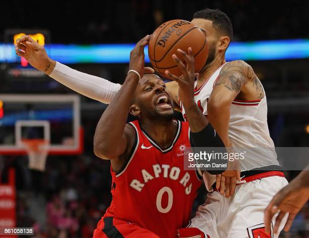 Miles of the Toronto Raptors tries to drive against Denzel Valentine of the Chicago Bulls during a preseason game at the United Center on October 13...