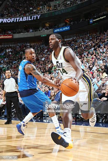 J Miles of the Utah Jazz controls the ball against Caron Butler of the Dallas Mavericks during a game at EnergySolutions Arena on December 03 2010 in...