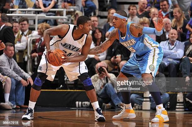 J Miles of the Utah Jazz looks to pass against Carmelo Anthony of the Denver Nuggets in Game Three of the Western Conference Quarterfinals during the...