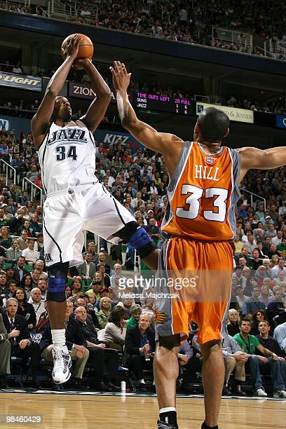 J Miles of the Utah Jazz puts up a shot over Grant Hill of the Phoenix Suns at EnergySolutions Arena on April 14 2010 in Salt Lake City Utah NOTE TO...