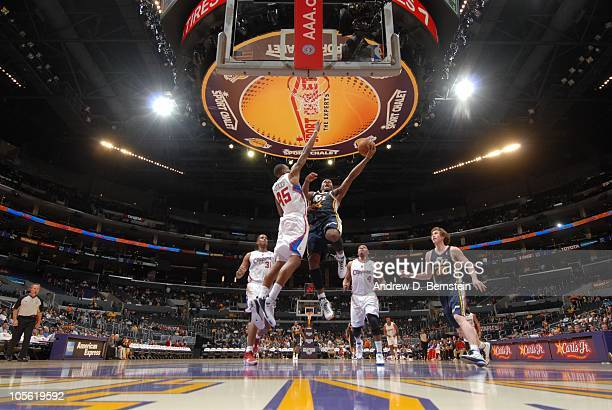 J Miles of the Utah Jazz rises for a layup against Rasual Butler of the Los Angeles Clippers at Staples Center on October 16 2010 in Los Angeles...