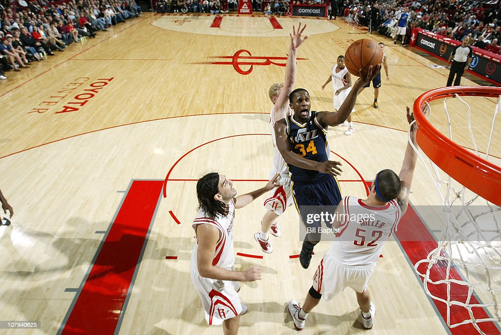 C.J. Miles #34 of the Utah Jazz shoots the ball over Brad Miller #52 of the Houston Rockets on January 8, 2011 at the Toyota Center in Houston, Texas.