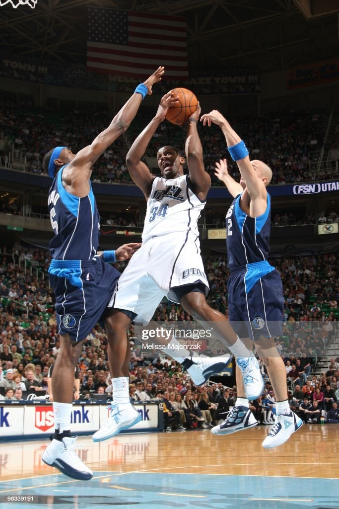 C.J. Miles #34 of the Utah Jazz splits the defense of Josh Howard #5 and Jason Kidd # of the Dallas Mavericks and goes up for the shot at EnergySolutions Arena on February 1, 2010 in Salt Lake City, Utah.