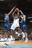 J Miles of the Utah Jazz splits the defense of Josh Howard and Jason Kidd # of the Dallas Mavericks and goes up for the shot at EnergySolutions Arena...
