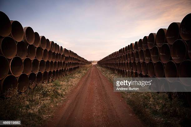 Miles of unused pipe prepared for the proposed Keystone XL pipeline sit in a lot on October 14 2014 outside Gascoyne North Dakota