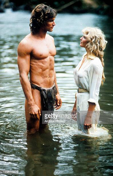 Miles O'Keeffe and Bo Derek stand in knee deep water looking at one an other face to face in a scene from the film 'Tarzan The Ape Man' 1981