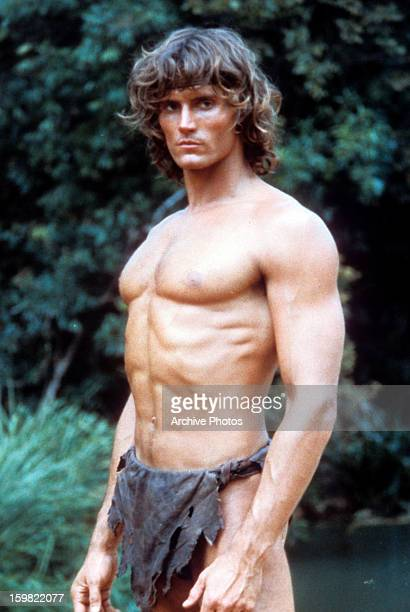 Miles O'Keeffe standing with his well defined muscles exposed in a scene from the film 'Tarzan The Ape Man' 1981
