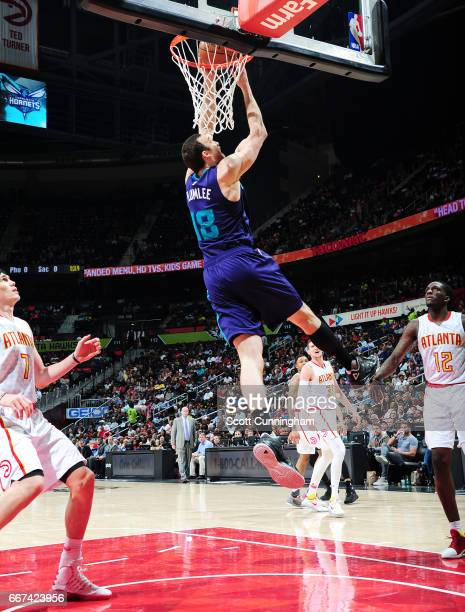 Miles Plumlee of the Charlotte Hornets dunks against the Atlanta Hawks during the game on April 11 2017 at Philips Arena in Atlanta Georgia NOTE TO...