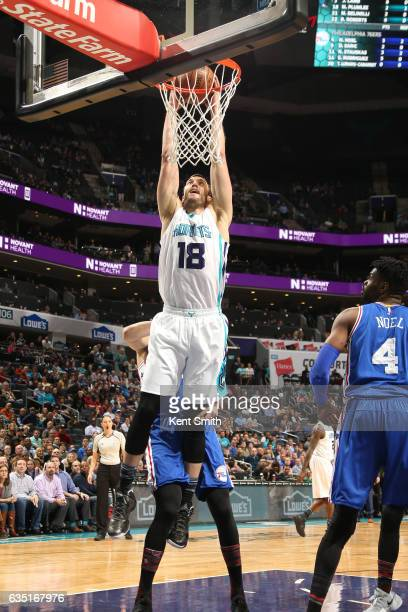 Miles Plumlee of the Charlotte Hornets dunks againsthe the Philadelphia 76ers on February 13 2017 at the Spectrum Center in Charlotte North Carolina...