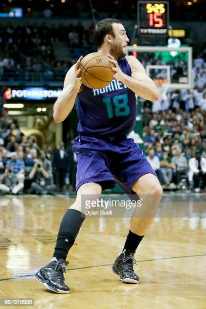 Miles Plumlee of the Charlotte Hornets handles the ball in the fourth quarter against the Milwaukee Bucks at BMO Harris Bradley Center on April 10...