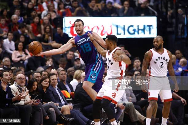 Miles Plumlee of the Charlotte Hornets saves the ball against the Toronto Raptors on March 29 2017 at the Air Canada Centre in Toronto Ontario Canada...