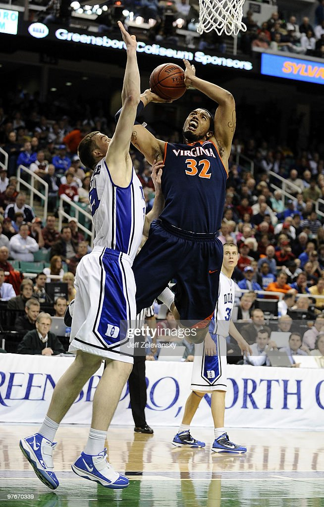 MIles Plumlee of the Duke Blue Devils guards Mike Scott of the University of Virginia Cavaliers in their quarterfinal game in the 2010 ACC Men's...