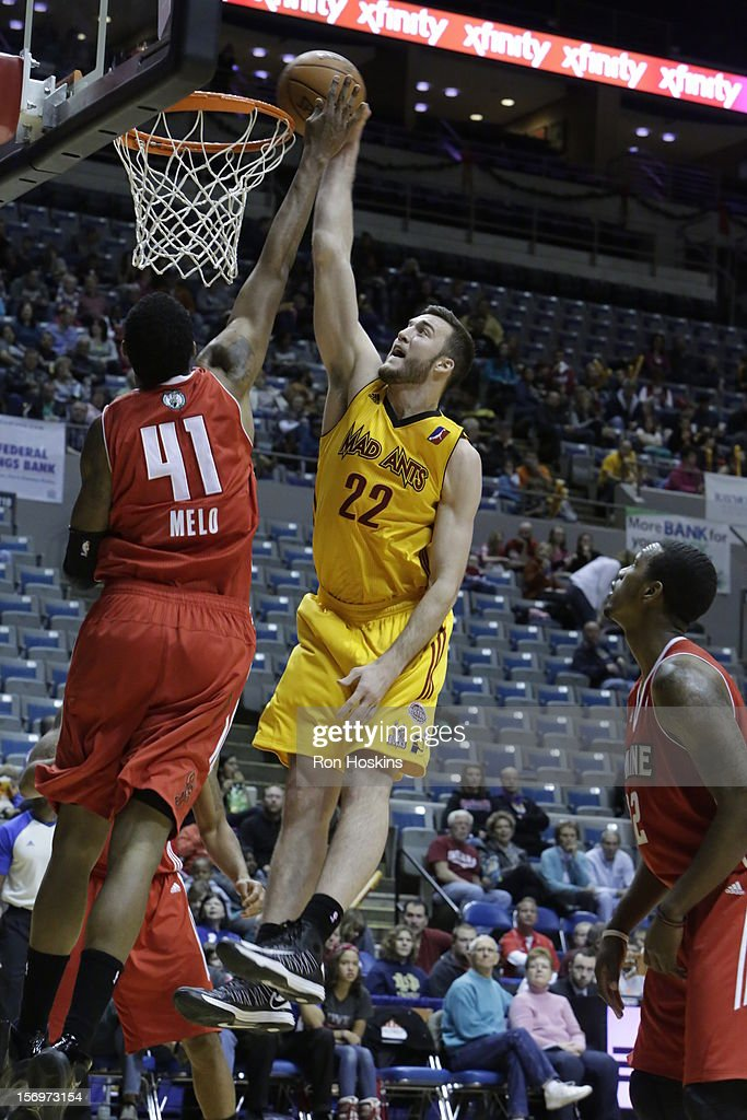 Miles Plumlee #22 of the Fort Wayne Mad Ants jams over Fab Melo #41 of the Maine Red Claws at Allen County Memorial Coliseum on November 25, 2010 in Fort Wayne, Indiana.