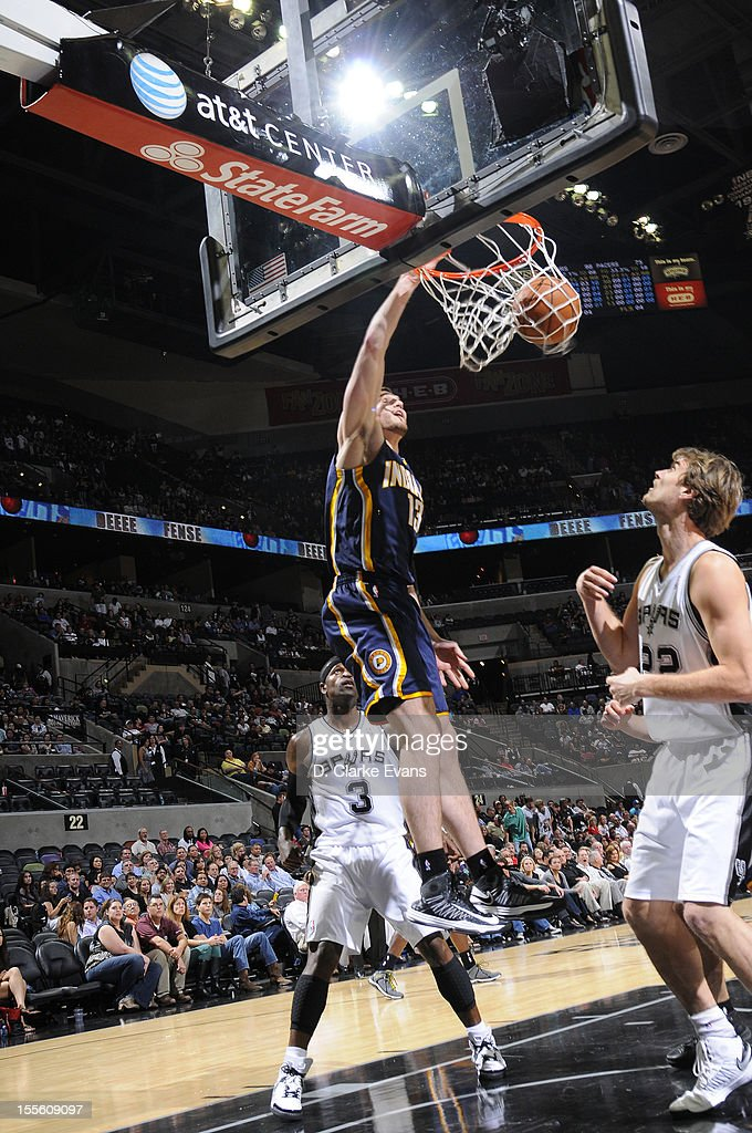 <a gi-track='captionPersonalityLinkClicked' href=/galleries/search?phrase=Miles+Plumlee&family=editorial&specificpeople=5645212 ng-click='$event.stopPropagation()'>Miles Plumlee</a> #13 of the Indiana Pacers dunks the ball during the game between the Indiana Pacers and the San Antonio Spurs on November 5, 2012 at the AT&T Center in San Antonio, Texas.