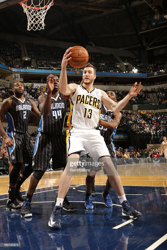 Miles Plumlee #13 of the Indiana Pacers grabs the ball against the Orlando Magic on March 19, 2013 at Bankers Life Fieldhouse in Indianapolis, Indiana.