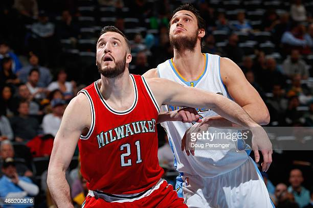 Miles Plumlee of the Milwaukee Bucks and Danilo Gallinari of the Denver Nuggets battle for rebounding position at Pepsi Center on March 3 2015 in...
