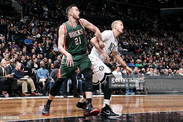 Miles Plumlee of the Milwaukee Bucks battles for position against Mason Plumlee of the Brooklyn Nets on March 20 2015 at Barclays Center in Brooklyn...